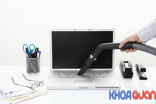 Man Vacuuming Laptop Computer