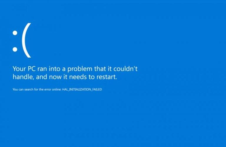 """Mà hình máy tính của bạn hiển thị dòng chữ """"Your PC ran into a problem and needs to restart"""" trên nền xanh"""
